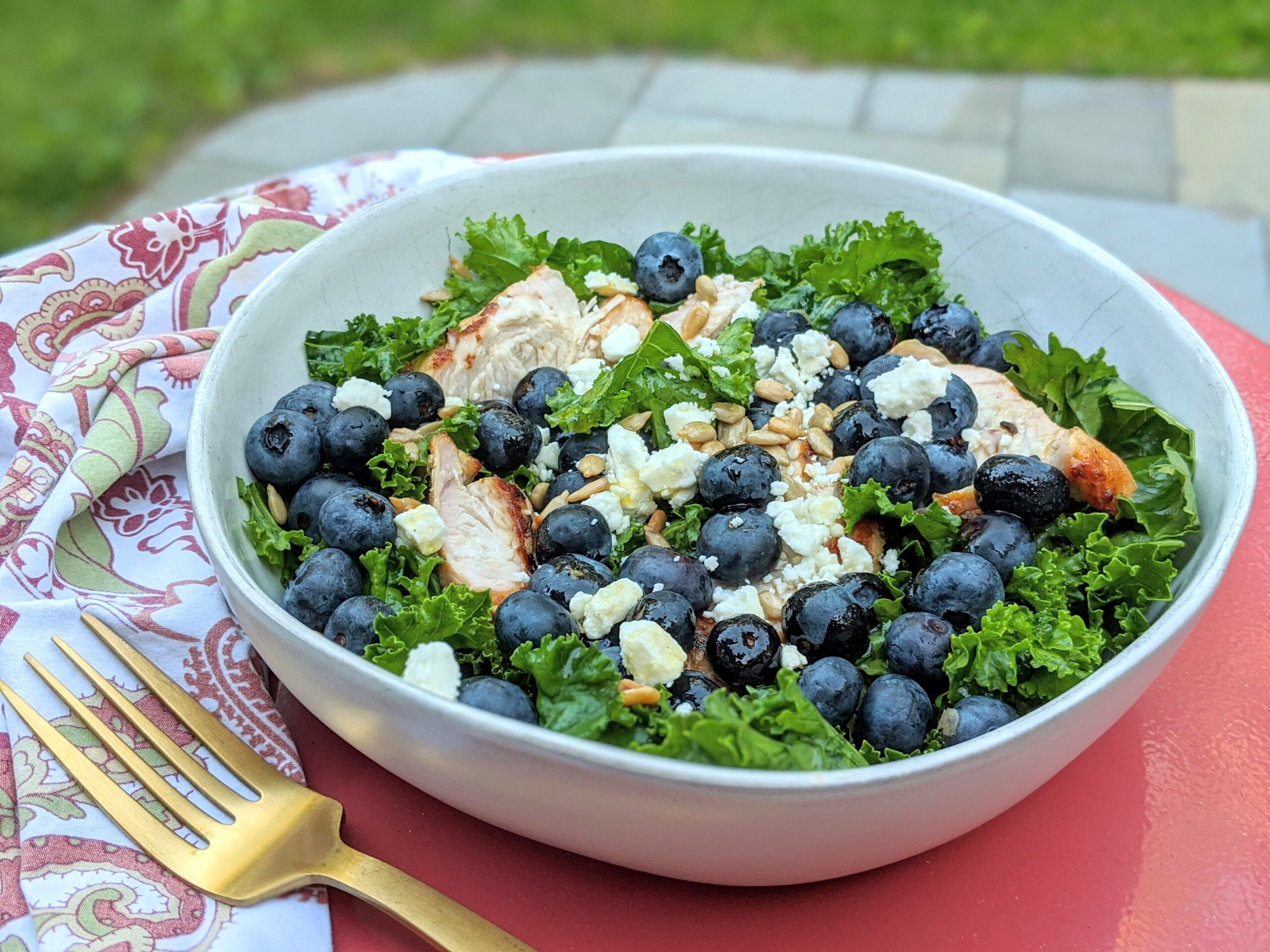 picture of kale and blueberry salad with grilled turkeky tenderloin